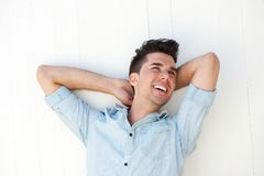 Happy young man laughing outdoors Royalty Free Stock Photography