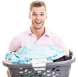 Happy young man with laundry basket Royalty Free Stock Photography