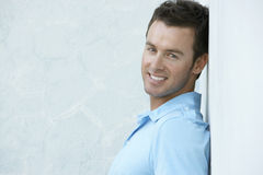 Happy Young Man Leaning Against Wall Royalty Free Stock Image