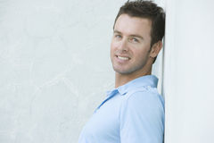 Happy Young Man Leaning Against Wall Stock Images