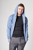Happy young man with light beard in blue hoodie Stock Image