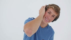 Happy young man listening to music Royalty Free Stock Photo