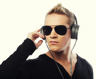 Happy young man listening to music with headphones Royalty Free Stock Photos