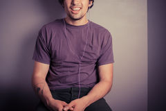 Happy young man listening to music Stock Images