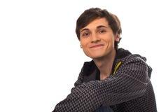 Happy young man looking at camera and smiling Stock Image