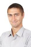 happy young man looking at camera at studio Royalty Free Stock Photography