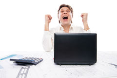Happy young man looking at laptop and gesturing Stock Images