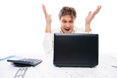 Happy young man looking at laptop and gesturing. Happy young man in formal wear looking at laptop and gesturing Royalty Free Stock Photo