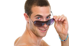 Happy young man looking out from sunglasses Stock Photos