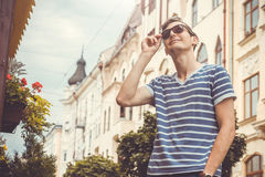 Happy young man looking up. In the old city Royalty Free Stock Photography