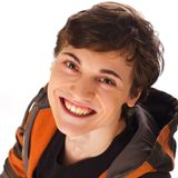 Happy young man looking up and smiling Stock Images