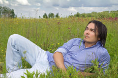 Man lying on a spring blossom meadow Royalty Free Stock Photography