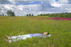 Man lying on a spring meadow Royalty Free Stock Photos