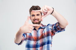Happy young man making frame with fingers Stock Image