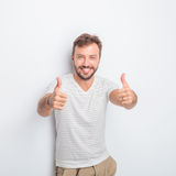 Happy young man making the ok  hand sign Stock Photos