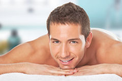 Happy young man after a massage Stock Images