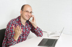 Happy young man at office Royalty Free Stock Photo