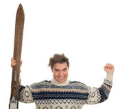 Happy young  man  with old wooden ski Stock Photo