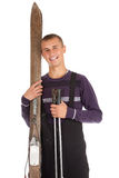 Happy young man with old wooden ski Royalty Free Stock Photos