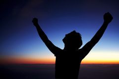 Happy young man open arms on sunset Royalty Free Stock Photo