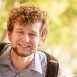 Happy young man outdoor portrait. Stock Photos