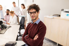 Happy young man over creative team in office Royalty Free Stock Photo