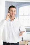 Happy young man on phone Stock Images