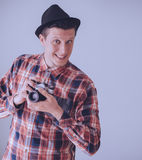 Happy young man with photo camera Royalty Free Stock Photos