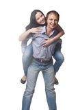 Happy young man piggybacking his girlfriend. Over white background Stock Image