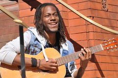 Happy young man playing guitar stock images