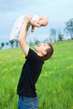 Happy young man playing his baby boy Stock Photo