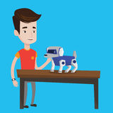 Happy young man playing with robotic dog. Stock Images