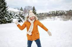 Happy young man playing snowballs in winter Stock Photography