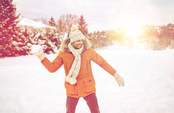Happy young man playing snowballs in winter Royalty Free Stock Photos