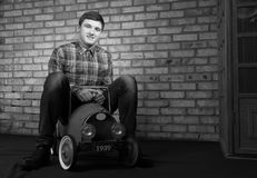 Happy Young Man Playing with Toy Car Stock Photography