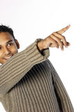 Happy young man pointing Stock Photography