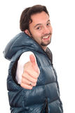 Happy young man pointing finger. Stock Photo
