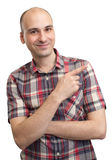 Happy young man pointing finger Stock Photos