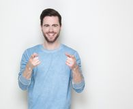 Happy young man pointing fingers Stock Image