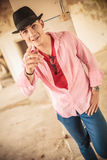 Happy young man pointing his finger Royalty Free Stock Images