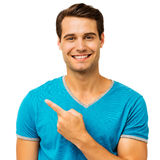 Happy Young Man Pointing Over White Background Stock Photos