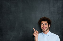 Happy Young Man Pointing Royalty Free Stock Photography