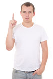 Happy young man pointing upwards over white background Royalty Free Stock Photos