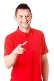 Happy young man pointing you Stock Photos