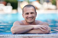 Happy young man in pool Royalty Free Stock Image