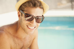 Happy young man by poolside stock photos