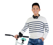 Happy young man. POrtrait of cheerful Asian man with bicycle and headphones around his neck Royalty Free Stock Photography