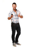 Happy young man posing with cellphone Stock Image