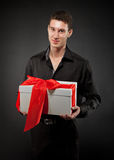 Happy young man with present Royalty Free Stock Image