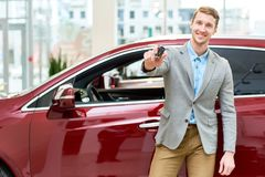 Happy Young Man Presenting Car Keys royalty free stock photography